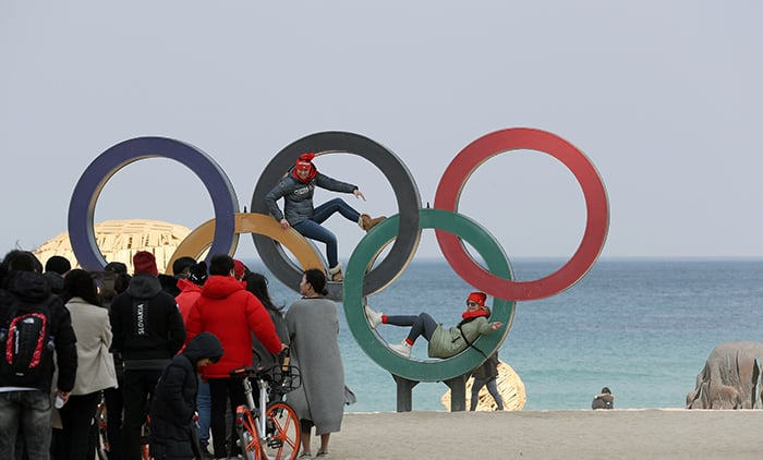 German athletes have fun taking photos with the Olympic rings at an outdoor square in front of Gyeongpo Beach in Gangwon-do Province on Feb. 22.