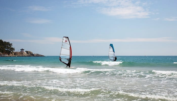 Surfers enjoy the waves at the Songjeong Beach in Busan. (Korea Tourism Organization)