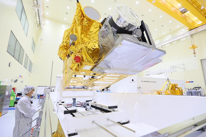 The new Chollian-2A geostationary weather satellite, to be launched from the Guiana Space Center at Kourou in French Guiana on Dec. 4 (local time), is being prepared for relocation by a researcher at the Korea Aerospace Research Institute (KARI) in Daejeon on Oct. 16. (Ministry of Science and ICT)