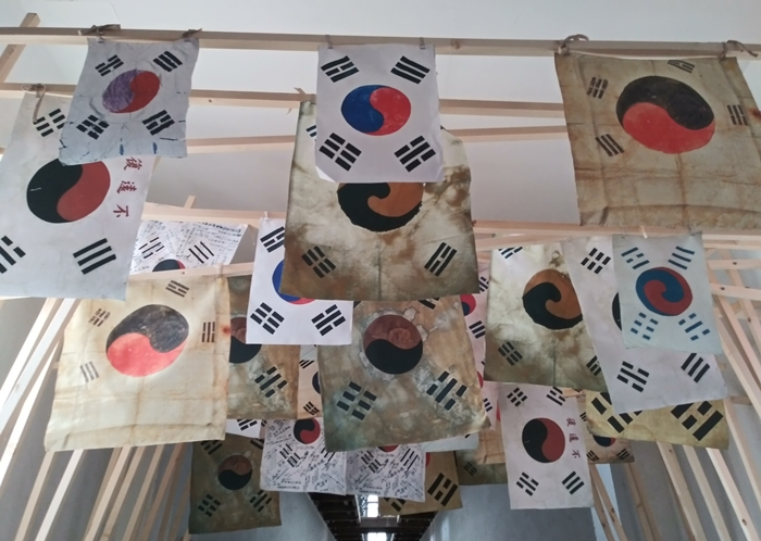 Shown here are flags used by Korean independence activists at Seodaemun Prison History Hall in Seoul. An exhibition there will run through April 21 to mark the centennial anniversary of the March First Independence Movement and the establishment of the Korean Provisional Government in China.