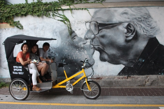 Jun, a pedal bike driver, introduces travelers to the history and hidden spots of Bukchon.