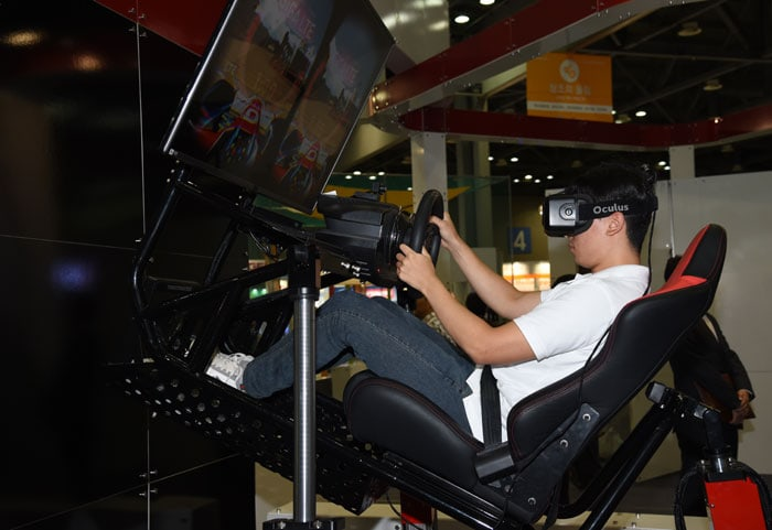 A visitor races a car in virtual reality.