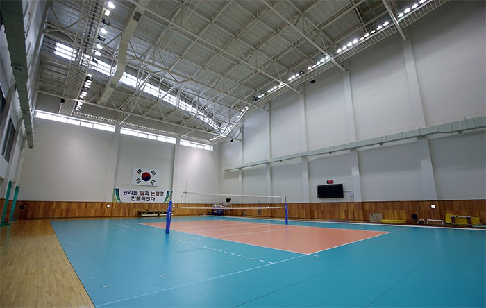 The multi-gym is used for volleyball, basketball and handball. A track and mat have also been installed along the side for use by the pole vault team.