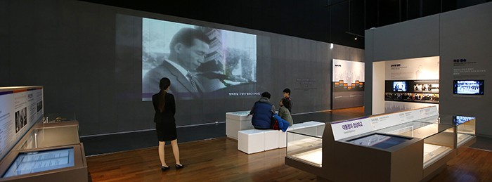 On March 3, a family visiting the Presidential Archives watches a video of a speech by former President Park Chung-hee.