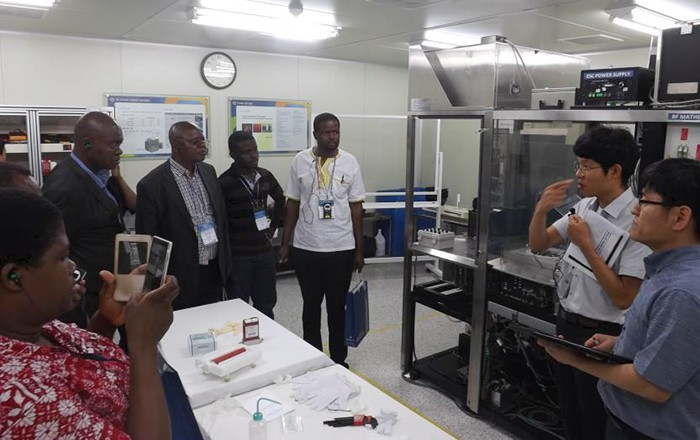 Participants in the vocational education policy training program inspect a laboratory at Chungbuk Semiconductor High School.