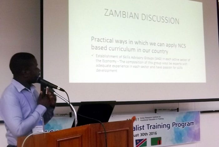 A participant from Zambia introduces vocational education policies from his home country.