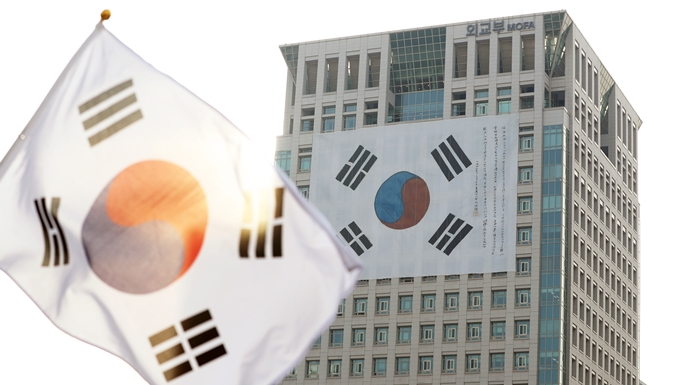 "This huge Taeguekgi (Korean national flag) hangs on a building at Seoul's Gwanghwamun Square to commemorate the centennial anniversary of the March First Independence Movement. On April 11, a ceremony to mark the centennial anniversary of the Korean Provisional Government was scheduled at Seoul's Yeouido Park under the slogan ""A history guarded by its people, a country led by its people."" (Jeon Han)"