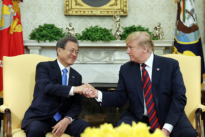 President Moon Jae-in and U.S. President Donald Trump on April 11 shake hands at the White House in Washington during their last summit. Both leaders will hold another summit in Seoul in June. (Cheong Wa Dae)