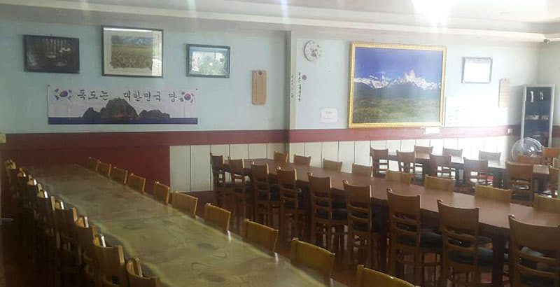 "This is one of the four restaurants in Laos owned by Youn Jae Wouk, who has run a campaign since 2016 affirming Korean sovereignty over Dokdo. All four have banners reading ""Dokdo is Korean territory."""