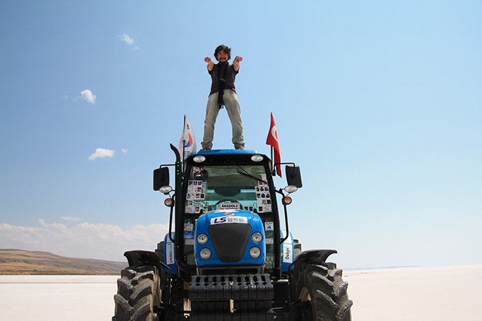 Kang Kitae poses atop his tractor during a trip in Turkey in 2012.