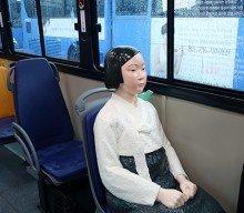 Statue of Peace boards Seoul bus