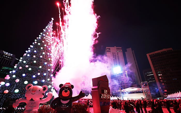 A lighting ceremony for a giant Christmas tree is held at Seoul Plaza on Dec. 2. The tree is next to statues of the two mascots for the PyeongChang 2018 Olympic and Paralympic Winter Games, Soohorang the white tiger and Bandabi the Asiatic black bear, and a clock tower that's counting down the days to the Winter Games Opening Ceremony in February next year.